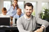 Young broker sitting at office — Stock Photo