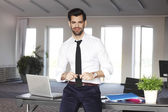 Young broker standing at office — Stock Photo