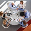 Business team sitting in a meeting — Stock Photo #77519710