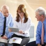 Business team analyzing financial data — Stock Photo #77519954