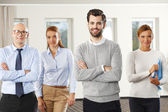Business people standing at office — Stock Photo