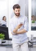 Professional at office using mobile — Stock Photo