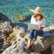 Casual woman working by sea — Stock Photo #78926676