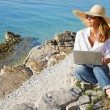 Casual businesswoman working by sea — Stock Photo #78926680