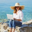 Casual female working by seaside — Stock Photo #78926688