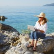 Casual woman working by sea — Stock Photo #78926710