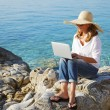 Casual woman working by sea — Stock Photo #78926714