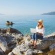 Casual businesswoman working by sea — Stock Photo #78926762