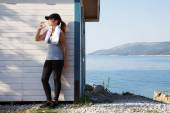 Woman by sea after running and drinking water — Stock Photo