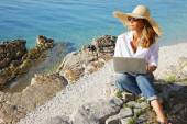Casual businesswoman working by sea — Stock Photo