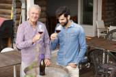 Young and senior men tasting wine — Stock Photo