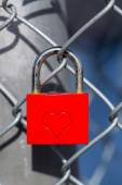 Red heart lock with a fence — Stock Photo