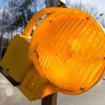 Traffic warning lamp in yellow on a street macro — Stock Photo #67265035