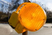 Traffic warning lamp in yellow on a street macro — Stock Photo