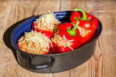 Stuffed peppers with meat sauce and cheese baked — Stock Photo