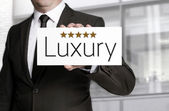 Businessman holding five star luxury sign — Stock Photo