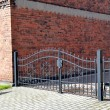 Forged iron gate outdoor, black grey fence. — Stock Photo #54942875