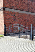 Forged iron gate outdoor, black grey fence. — Stock Photo