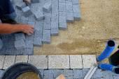 A worker made a sidewalk from bricks. — Stock Photo