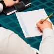 Making notes. Close-up of man in formalwear writing something in his note pad — Stock Photo #67164337