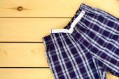 Blue shorts on wooden background — Stock Photo