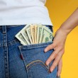 Money in pocket and woman hand on it — Stock Photo #73920267