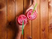 Loving couple hands holding colorful chilled cocktails toasting cheers — Stock Photo