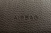 "Word ""Airbag"" written on car's dashboard. — Stock Photo"