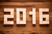 2016 New Year in shape from wooden cubes. — Stockfoto