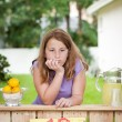 Bored young girl with no customers at her lemonade stand — Stock Photo #73460461