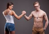 Man VS woman in an arm wrestling  — Stock Photo