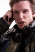 Young man upset calling on mobile phone — Stock Photo
