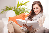 Beautiful fascinating woman reading a book — Stock Photo