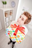 Clerk with a big gift in wide-angle — Stock Photo