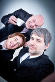 Group of yuppies making themself a selfie — Stock Photo