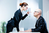 Woman reproaching man at work — Stock Photo