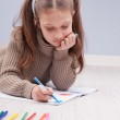 Little girl colouring on her notebook — Stock Photo #58420109