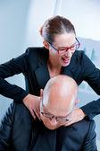 Business woman relishing his sadism — Stock Photo