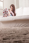 Pretty teenager girl checking her mobile phone — Stock Photo