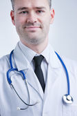 Self confident available doctor in white coat — Stock Photo