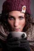 Woman with a mugful of a hot drink — Stock Photo