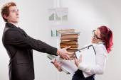 Man overloading colleague with work — Stock Photo