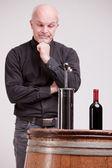 Doubtful man about wine quality controls — ストック写真