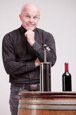 Doubtful man about wine quality controls — Stock Photo