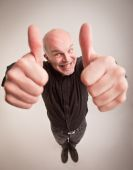Happy man and thumbs up in wideangle — Stock Photo