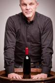 Proud wine maker man with a bottle — Stock Photo