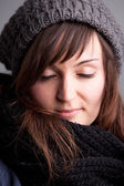 Closed eyes girl with hat and scarf — Stock Photo
