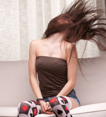 Hair in the air by a young pretty woman — Stockfoto