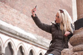 Blonde tourist making a selfie outdoors — Stock Photo