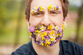 Happy man with flower beard and eyebrows — Stock Photo